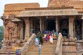 Thanjavour, India - February 14: An Unidentified Indian People Run Rise At The Brihadeeswarar Hindu