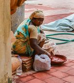 Thanjavour, India - February 14: An Unidentified Indian Woman  In National Costumes Stirs The Red Dy