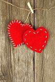 Valentines Day cloth hearts on wood