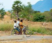 Trichy, India - February 15: An Unidentified Three Teenage Boy Riding A Bike On A Rural Road. India,