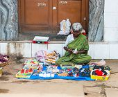 Trichy, India - February 15: An Unidentified Indian Woman Sells Haberdashery Sitting On The Pavement
