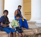 Madurai, India - February 16: An Unidentified Young Men Are Sitting At The Ancient Tirumalai Nayak P