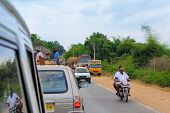 Thanjavour, India - February 13: An Unidentified Indian Men Are Riding  A Motorcycle At The Traffic