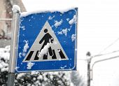 picture of pedestrian crossing  - pedestrian crossing sign in mountain village during heavy snowstorm - JPG