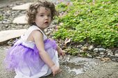image of tutu  - little girl in purple tutu playing in the garden - JPG