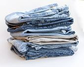 The jeans of various shades in a pile