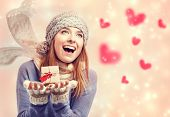 Happy Young Woman Holding A Small Present Box With Hearts