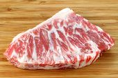 stock photo of hump  - A piece of fresh and raw Beef hump on a wooden background - JPG