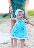 Mother And Her Baby Girl Having Fun At The Beach