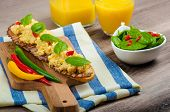 foto of scrambled eggs  - Scrambled eggs English style bacon fresh salad of spinach and microgreen chilli pepper orange juice - JPG