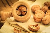 Walnut With Nutcracker On Rustic Table