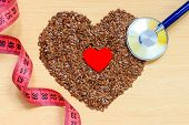 Raw Flax Seeds Heart Shaped And Stethoscope