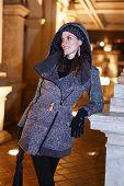 Fashionable Woman In Long Coat Posing Outdoor On Corridor