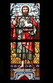 VIENNA, AUSTRIA - OCTOBER 11: Saint John the Baptist, stained glass in Minoriten kirche in Vienna, Austria on October 11, 2014.