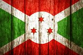 image of burundi  - Grunge Burundi Flag painted on wood background - JPG