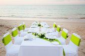 image of wedding table decor  - Dinner table setup for wedding ceremony on beach - JPG