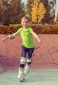 Little girl on roller skates  at a park
