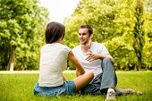 Young couple talking outdoor