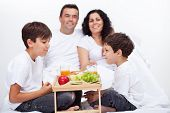 Fresh fruits breakfast in bed for family with kids