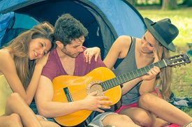 stock photo of sluts  - three young adults making party on camping - JPG