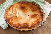 pic of crust  - Home baked pie with a golden puff pastry crust baked in enamelware pie dish can be used for savory or sweet fillings - JPG