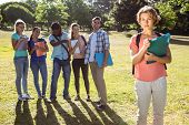 foto of school bullying  - Student being bullied by a group of students on a sunny day - JPG