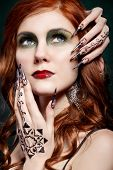 picture of long nails  - portrait of a girl with red hair and long nails on her face with red lipstick and pattern of mehandi on hand - JPG