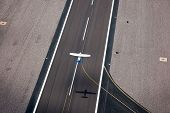 pic of lifting-off  - Small single engine plane taking off as viewed from above - JPG