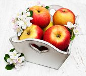 pic of apple blossom  - box with apples and apple tree blossoms on a wooden table - JPG