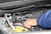 image of car repair shop  - auto mechanic is working on engine in car repair shop  - JPG