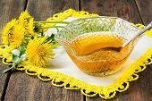 foto of dandelion  - Useful jam of dandelions in the socket dandelion flowers on a napkin and wooden background - JPG