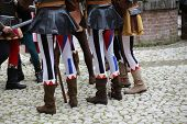 stock photo of ceremonial clothing  - medieval reenactment with costumed characters and ancient clothes - JPG