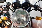 foto of headlight  - The headlight of classic motorcycle close up - JPG