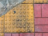 image of paved road  - image of close up at Tactile paving texture for blind handicap on the road - JPG