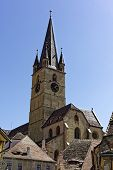 picture of sibiu  - Evangelical Cathedral Sibiu Romania tower on blue sky medieval architecture - JPG