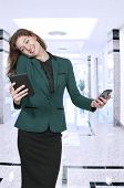 stock photo of juggling  - Beautiful woman talking texting and multitasking while juggling multiple cell phones and conversations - JPG