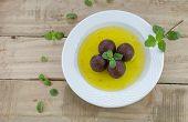 picture of jamun  - gulab jamun in sugar syrup in a dish - JPG