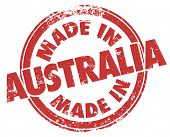 picture of manufacturing  - Made in Australia words in red ink and grunge style stamp to illustrate pride in products manufactured in the country or continent down under - JPG