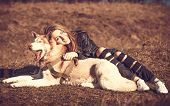 picture of wolf-dog  - Girl in the forest with her husky dog - JPG