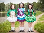 pic of cross-dress  - Three young beautiful girls in irish dance dress and wig posing outdoor - JPG