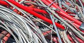 stock photo of dump  - Big Red Cord and other lengths of copper wire in the dump of special material - JPG
