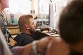 pic of barber  - Male Barber Giving Client Haircut In Shop - JPG