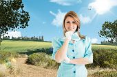 image of air hostess  - Air hostess against scenic backdrop - JPG