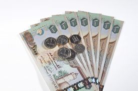 picture of dirham  - One thousand Dirham currency notes and coins on white background - JPG