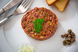 image of tartar  - Beef steak tartar with onion capres and toasted bread  - JPG