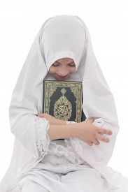 image of islamic religious holy book  - Pretty Muslim Girl Loves Holy Book of Quran Isolated on White Background - JPG