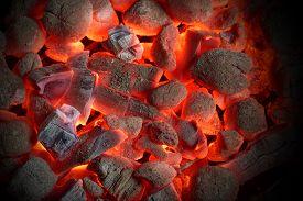foto of charcoal  - Glowing Hot Charcoal Briquettes Close - JPG