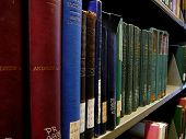 stock photo of book-shelf  - a shelf of books organized at a local library - JPG