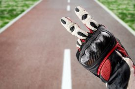 stock photo of biker  - gesture of biker greeting on the road - JPG