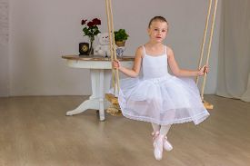 pic of fairy tail  - Portrait of little cute ballerina on swing - JPG